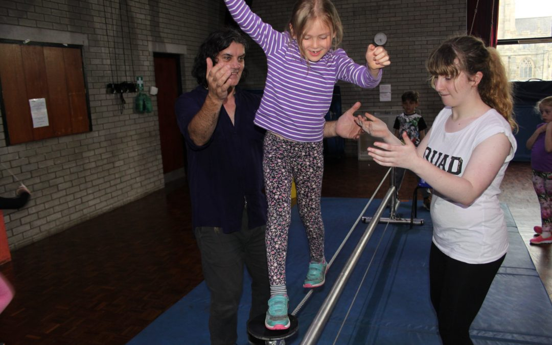 Skylight Circus Greater Manchester NW helping on the low tightwire